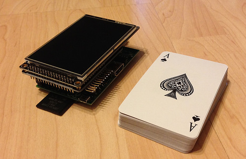 PiScreen next to a card deck, for size comparison