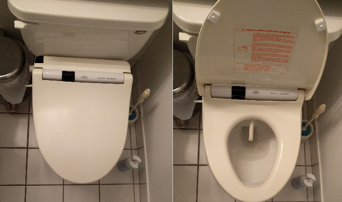 The installed toilet, with the wand exposed in the right